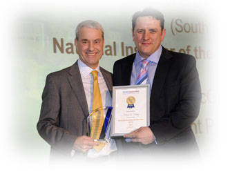Alan-Smith-Brett-Paving-MD-awarding-Paramount Paving 2012